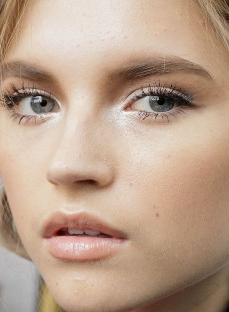 Natural peach tones, light hand in application. Slightly highlights eye, single lashes, dark brown/black shadow winged ever-so-slightly at the outer corner to draw out the eye and smoked out slightly.