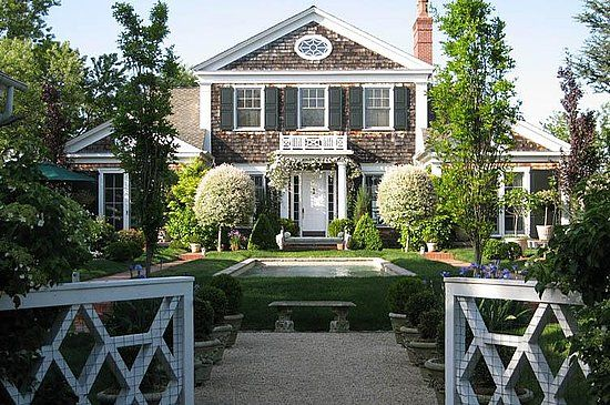 Absolutely beautiful East Hamptons shingle style home. Fantastic layered symmetry.  Love the center water feature, potted boxwoods, chinese chippendale entrance gate, peastone walk....just perfect.
