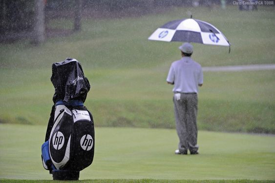 """""""Sluman endures a downpour -- Jeff Sluman waits during a downpour on the ninth green during the final round of the Regions Tradition at Shoal Creek. Weather plays such an important part of our sport and when it turns ugly, it is a long day for everyone."""" - Chris Condon, PGA TOUR Photographer"""