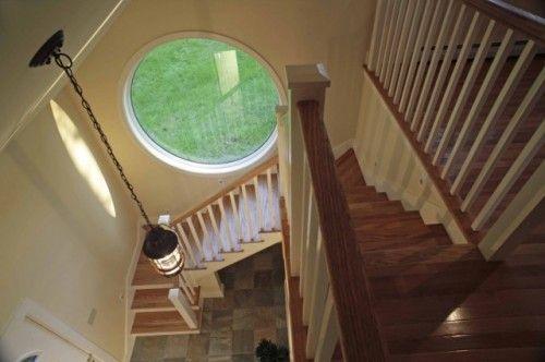 Round window in stairwell of Garage Apartment