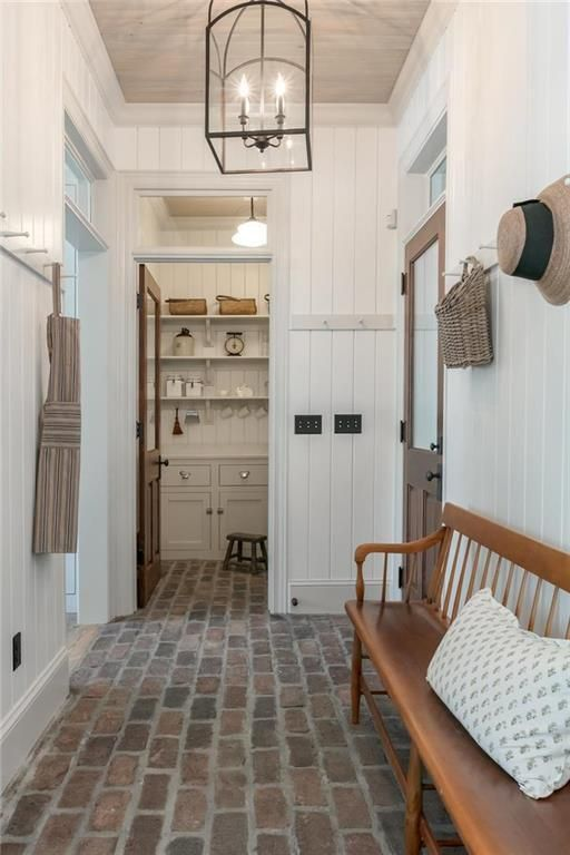 Recreating the Look of an Old Farmhouse in Kansas - Hooked on Houses #farmhouse #mudroom #brickfloor