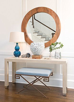 large mirror, simple console, blue lamp: