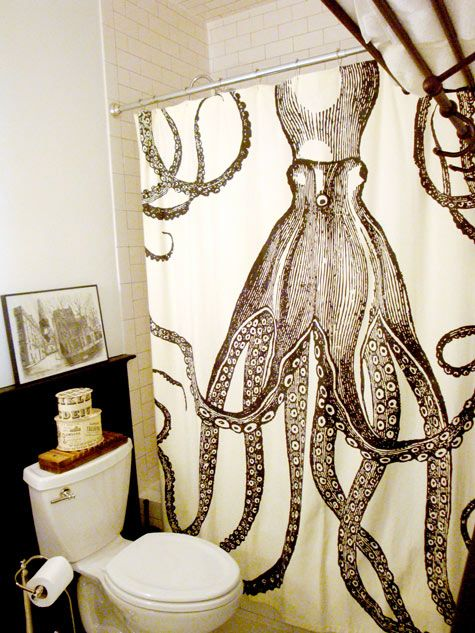 Octopus shower curtain in a black and white/ivory bathroom
