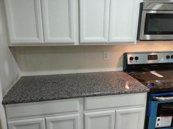 interesting kitchen granite countertops | Caledonia granite countertops and blue appliances make a ...
