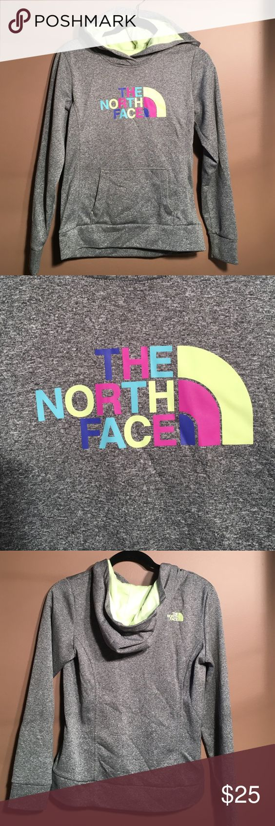 "North Face Sweatshirt Hoodie North Face heather grey hoodie w neon green interior hood. Multi color half dome logo on front, North Face name on back shoulder in neon green. Great condition and super cute and stylish. 100% polyester. Machine wash cold, tumble dry low. NO thumb holes, just a traditional cuff. Approx 18"" from pit to pit when laid flat. Approx 24"" from top of shoulder to bottom hem. Approx 24"" sleeve length from top of shoulder to cuff/wrist. Shown with size 4 American Eagle…"