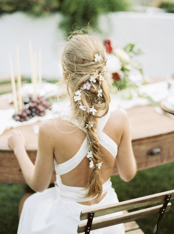 A pretty boho Fishtail braid with a touch of pretty flowers: itakeyou.co.uk: