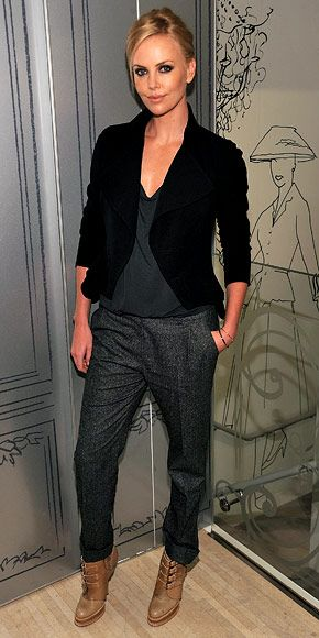 Charlize Theron always finds a way to work some edginess into her ensembles; here it is the leather jacket, contrasting boots, and smoky eye makeup.