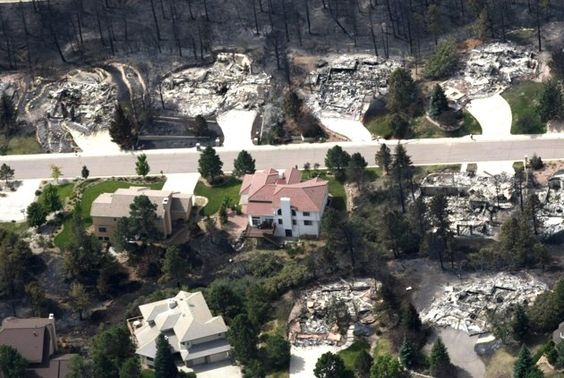 A mix of intact and totally destroyed homes are seen from the air in the aftermath of the Waldo Canyon fire in Colorado Springs
