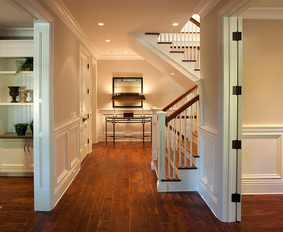 Lovely foyer design with staircase dutch colonial home for Colonial foyer ideas