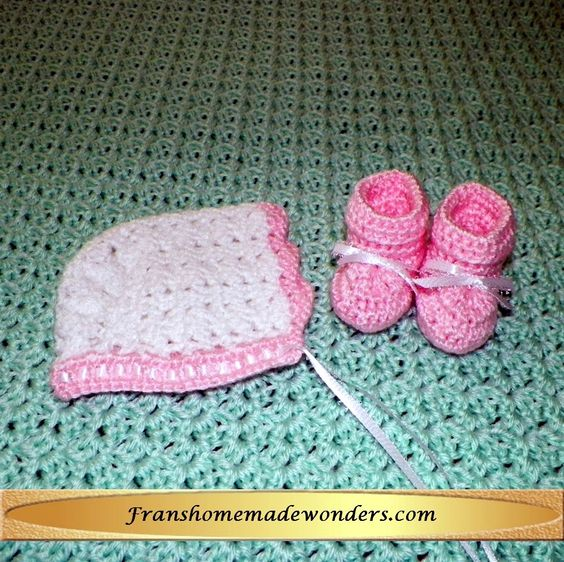 HANDMADE 0-3 MONTHS SIZE - WHITE AND PINK TRADITIONAL BONNET and PINK BOOTIES     $16.00    These entirely handmade old fashioned traditional style caps are hand crocheted using the softest baby yarn available, with a satin ribbon.    These entirely handmade booties are hand crocheted using matching yarn with or without an attached scalloped edged sock and removable ribbons.  The sole is approximately 3 inches.   Order at www.franshomemadewonders.com