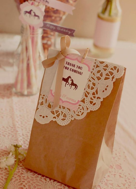 Favor bags at a vintage pony party  Love the larger, corner-cut doily instead of the full small circle