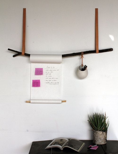 Use an old tree branch and a vintage belt to make this minimalist display for notes and pens.