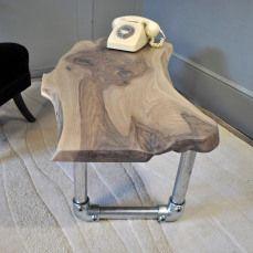 http://handmadeinbrighton.com/public/2015/04/gallery/bespoke-waney-edge-walnut-scaffold-coffee-table/