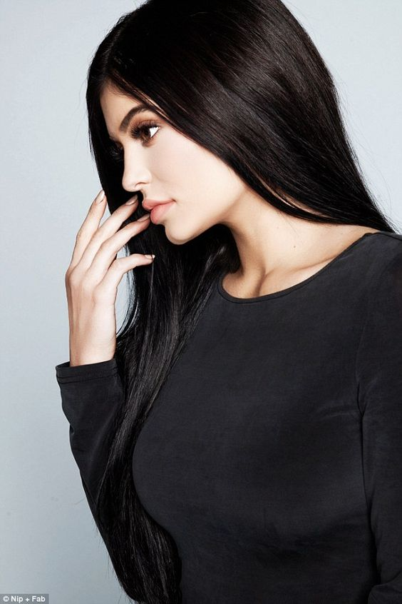 Raven-haired beauty: Kylie Jenner wears on a modest crew-neck top in the latest images for...