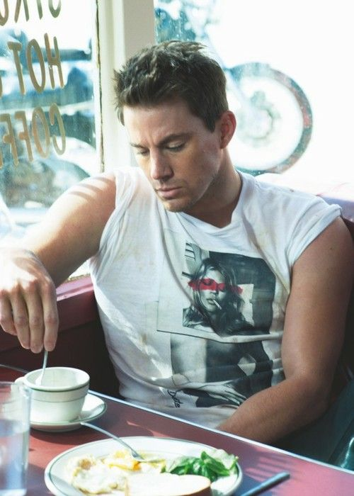 Tatem. STIRRING HIS COFFEE.