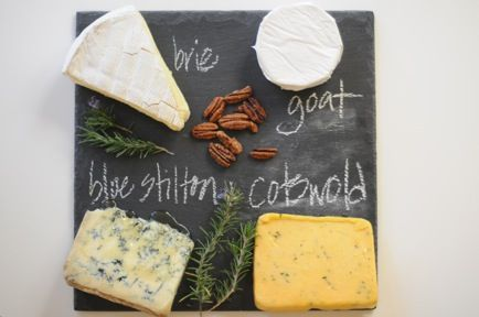 Slate cheese board sets off cheese nicely. Use soap stone (or chalk?) to label. Humm- good present for cheese lovers!