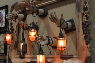 He painted the hands, the lights are from Ikea and either the bulbs are special or the glass is colored