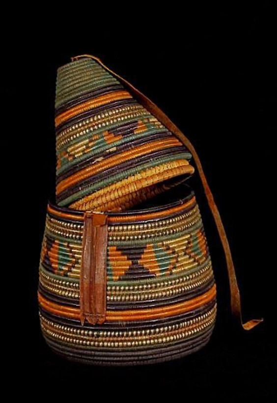 Africa | Basketry container for a coffee maker. | Plant fiber, leather and dyes | Arabic; Omdurman, Sudan, ca. 1905.
