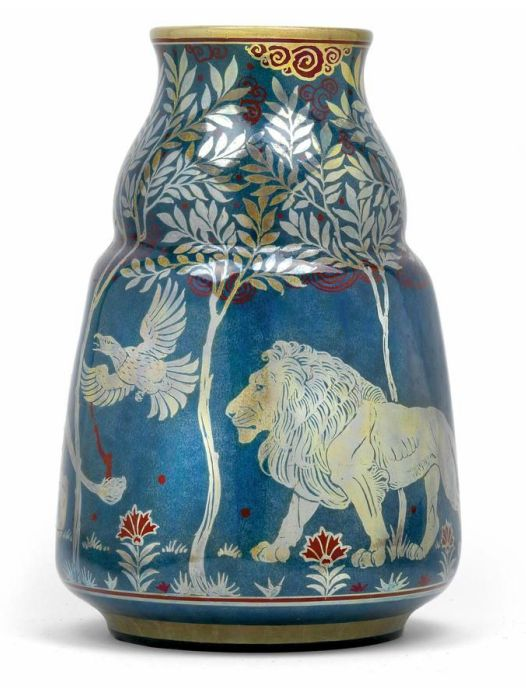 Richard Joyce, A vase decorated with lions,  designed in 1907, manufactured by Pilkington Royal Lancastrian, ceramic ware, covered with a coloured lustre glaze and decorated with a frieze of lions and a stylized alley of trees, the underside with artist's monogram, impressed factory mark, model number and year letter, height 25.2 cm,