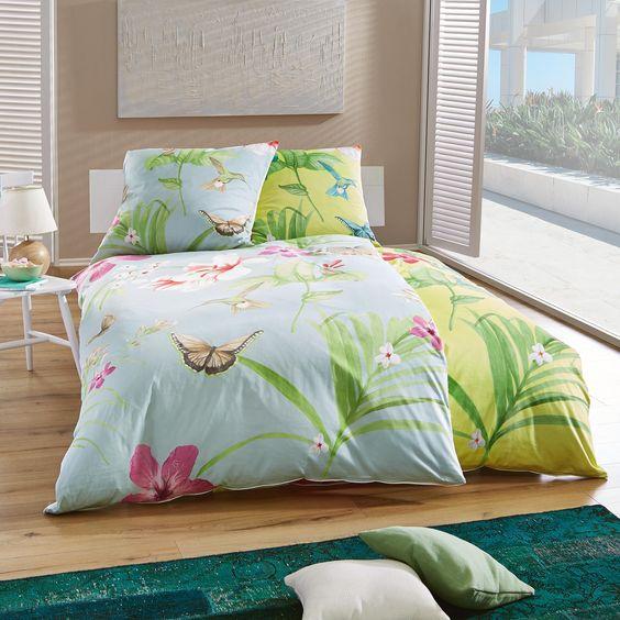 """Die 2-teilige Bettwäsche """"Milano"""" bringt einen Hauch von Hawaii in Ihr Schlafzimmer! Blumen, Palmen, Schmetterlinge und Kolibris sorgen für ein paradiesisches Design. Mit den Bezügen in Türkis verleihen Sie Ihrem Bett einen besonderen Farbakzent. Die Oberfläche aus Mako-Satin ist besonders hautfreundlich und pflegeleicht. Träumen Sie in dieser Bettwäsche von einsamen Südseestränden und beeindruckenden Tropenlandschaften!"""