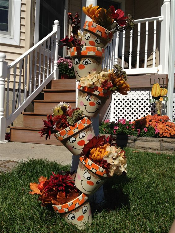 Terra cotta pots painted and then dropped down a dowel rod. Stuff with silk flowers :) can also make snowmen for winter????: