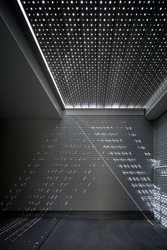 Light Grain is a minimalist residence located in Osaka, Japan, designed by Yoshiaki Yamashita Architect & Associates.