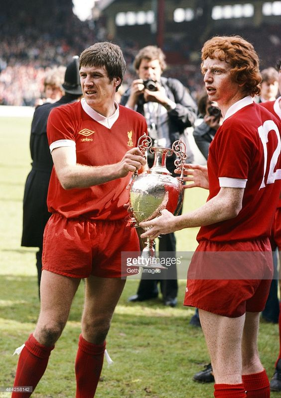 Liverpool players Emlyn Hughes (l) and 'super sub' David Fairclough with the Football League First Division trophy for the 1976/77 season after the match against West Ham United on May 14, 1977 in Liverpool, England.