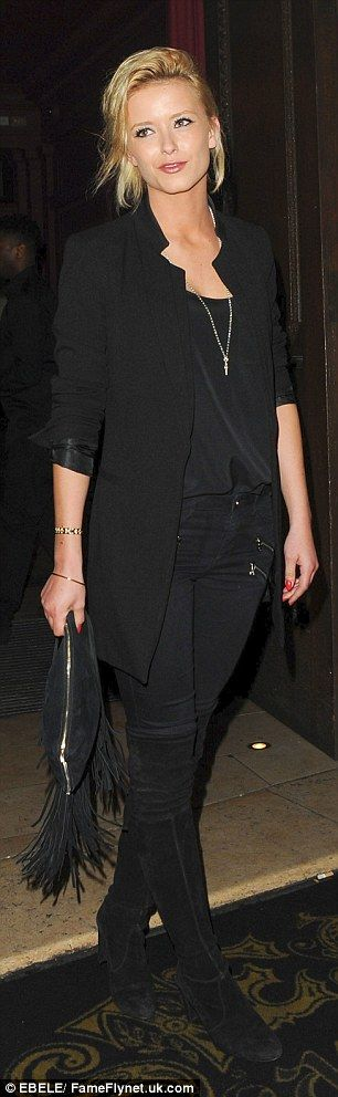 Stylish: Olivia styled her short blonde locks in a quirky manner and clasped a tasseled cl...