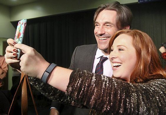 Kelsey Keegan of Duluth takes a photo of herself and actor Jon Hamm during the DFL candidate rally at UMD. (Bob King/rking@duluthnews.com)