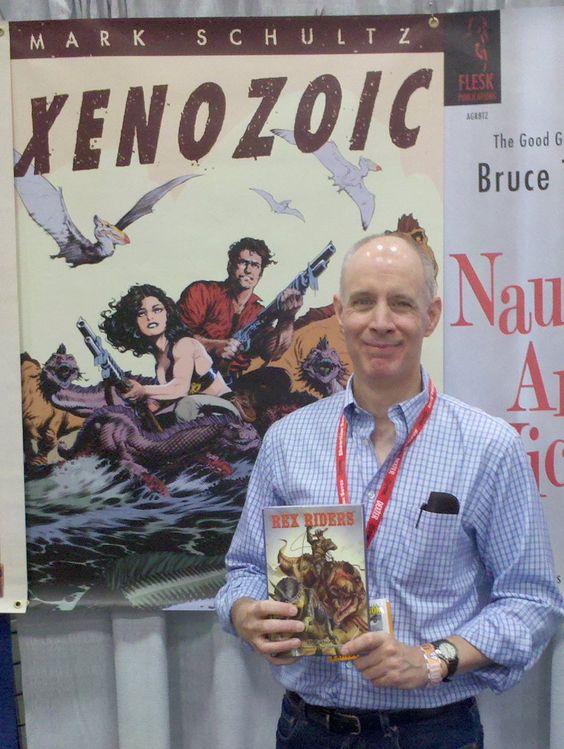 Mark Schultz, creator of Cadillacs & Dinosaurs and Xenozoic shows off his copy of REX RIDERS at Comic Con. #MarkSchultz #Art #Comics