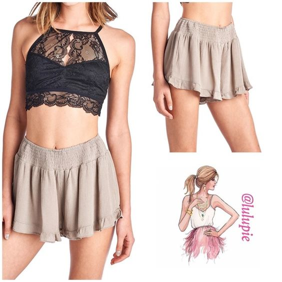 Taupe Ruffle Shorts Must have item for the summer! These cute taupe ruffle shorts go with everything. Pair them with a tee, crop top, or tank top. Shell 100% Rayon. Lining 100% Poly   Model wearing small. Pastel April Spirit Shorts