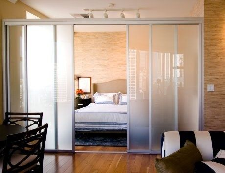 studio apartment idea - love the sliding doors for privacy