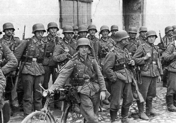 "Infantrymen of 506.Infantry Regiment during one of the long marches in 1942. Contrary to popular belief, the ""mechanized"" German army sent 70% of its forces into Russia on foot. Horses continued to haul the bulk of German supplies, provisions, and ammunition. Just like these men in the photo, survival for the German foot soldier depended largely on his endurance during endless marching."