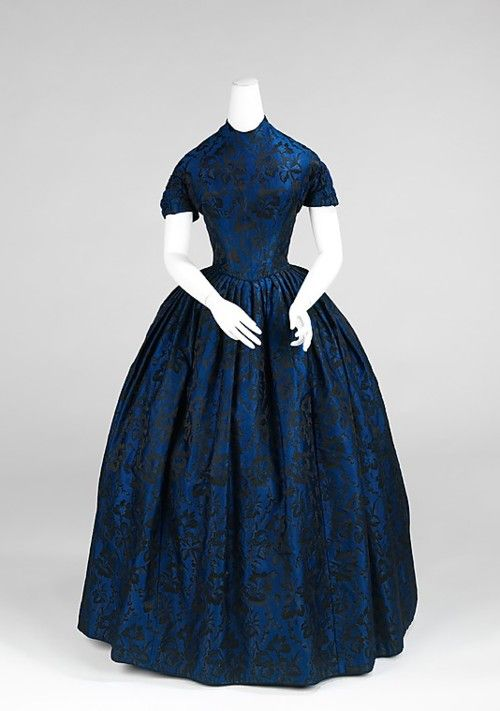 Evening Dress  1850-1852. With detachable long sleeves. Dark blue / Emerald green, patterned fabric such as in the picture.:
