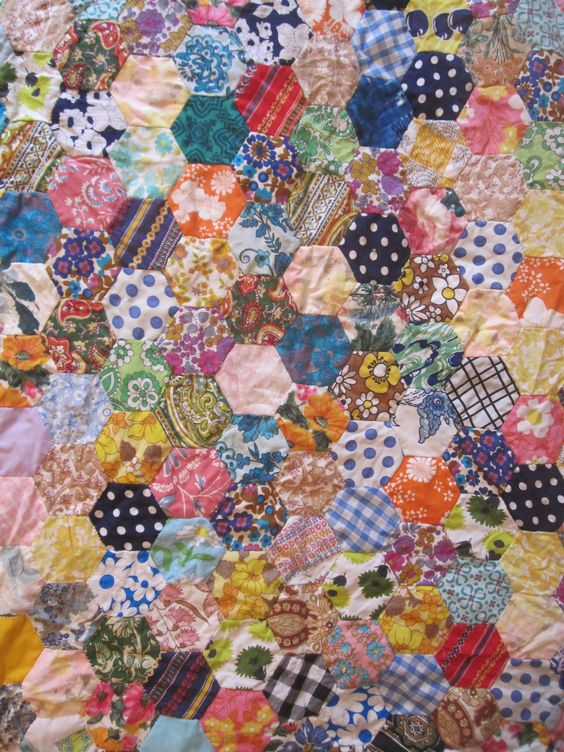 One of a selection of vintage patchwork quilts by Kitty Greenway
