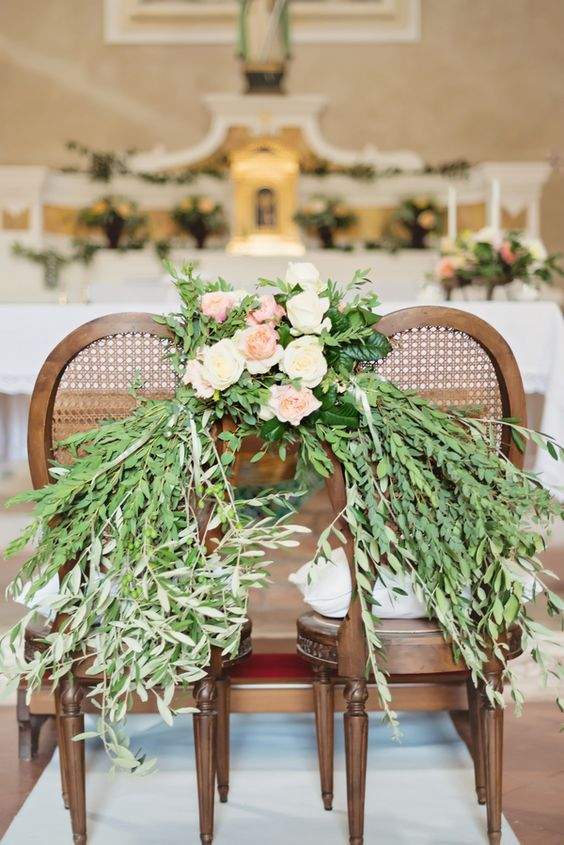 Floral Garland on Church Chairs Italian Wedding | photography by http://rochellecheever.com
