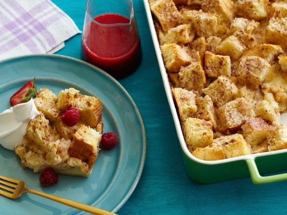 Sweet Southern-Style Bread Pudding: Ideal for entertaining, this big-batch dessert yields a moist, cinnamon-laced casserole, best served with fluffy whipped cream and sweetened berry sauce. #RecipeOfTheDay