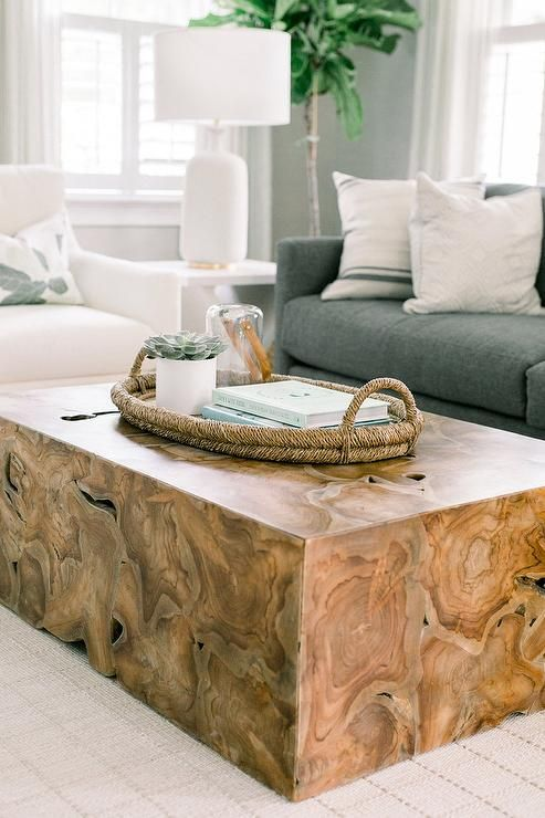 An Oval Rope Tray Accents A Wood Block Coffee Table Positioned On A White Grid Rug In Front Coffee Table Wood Coffee Table Living Room Living Room Coffee Table