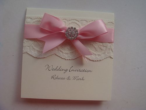 Vintage wedding invitation with lace, satin ribbon and crystal embellishment