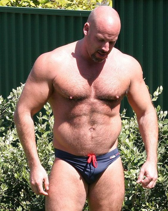woof bear  Any man brave enough to wear a speedo is sexy to me!!! Hair or no hair LOL And this guy ain't all bad :-)