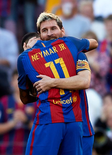Lionel Messi of FC Barcelona celebrates scoring his team's fourth goal with his teammate Neymar JR during the La Liga match between FC Barcelona and...