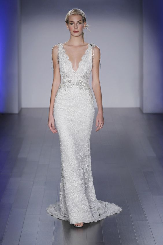 Lazaro 3501 Ivory and Silver alençon lace trumpet gown, V neckline with beaded necklace at back, jeweled appliques at natural waist, and chapel train