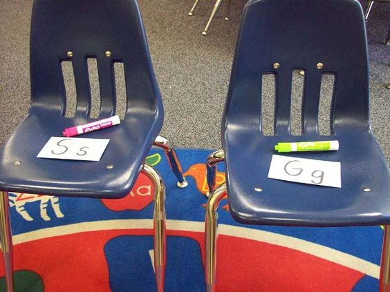 """""""Musical Letters""""-when music stops write letter that is on chair (try with sight words, too)"""