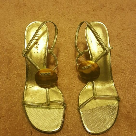 Strapped lime green with tortoise medallion  8.5 Never worn only tried on, on great condition please see pictures. Great for spring dress up with jeans or cute spring dress. Mixit Shoes Sandals