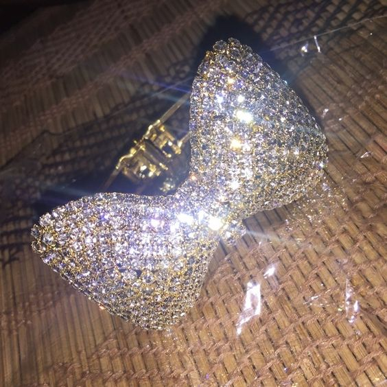 Gorgeous Bow Bangles!  Stunning diamond bangles with bows!  I have both gold and pink! $20 each, if you want both, I can bundle! Jewelry Bracelets