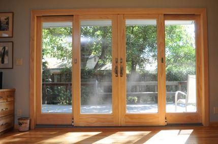 Andersen 4 panel frenchwood gliding patio door patio for Center sliding patio doors