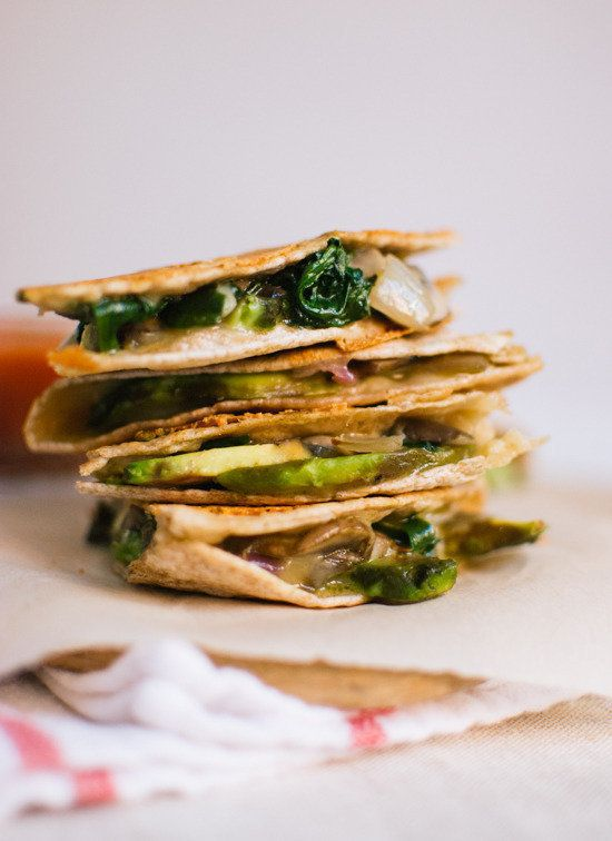 Quesadillas stuffed with vegetables and greens (and cheese, of course), as well as creamy slices of ripe avocado.