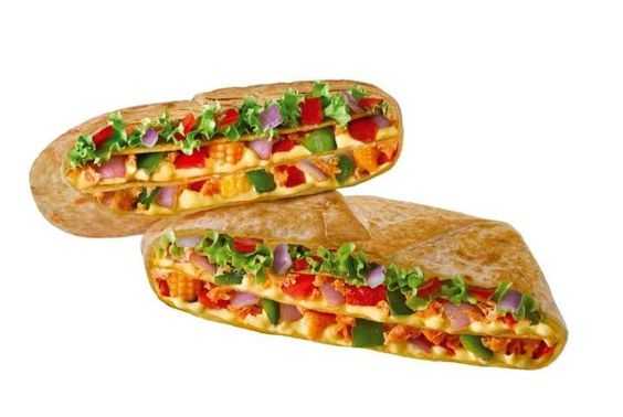 Taco Bell India - New Double Crunchwrap |  Pictured is the Chipotle Veg version and it comes with two layers of cheese, chipotle seasoning, soy protein, red and green bell peppers, baby corn, coriander, and onions, plus a third layer of lettuce, tomatoes, and onions. It's also available in a chicken version.