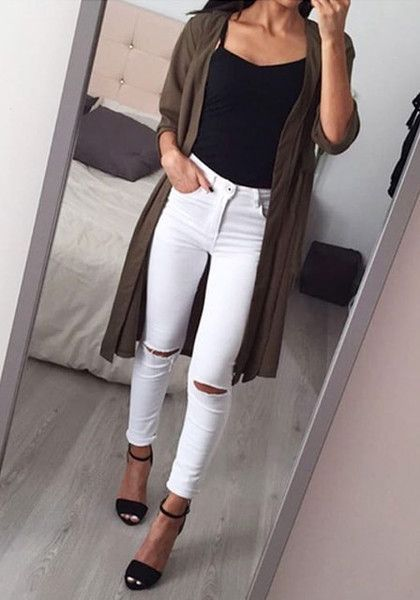 This classic white ripped skinny jeans is styled with distressed detailing in the knee areas, five pockets and zip fly button. Click here to shop today. | Lookbook Store