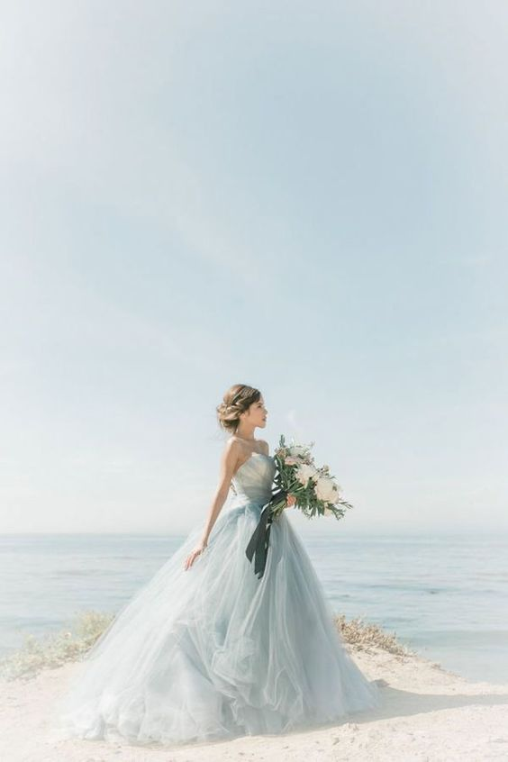In a blue wedding dress in the shade of the ocean and made of fabric as delicate as sea foam, you'll look like a mermaid. You'll have the same enchanting effect on everyone who sees you and don't be surprised if you score more than one heart on your wedding day.: